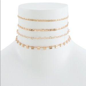 Jewelry - 4 Multi Chain Gold Tone Choker Set